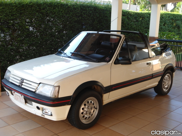 curbside capsule 1989 peugeot 205 convertible fun in the sun or snooze in the shade. Black Bedroom Furniture Sets. Home Design Ideas