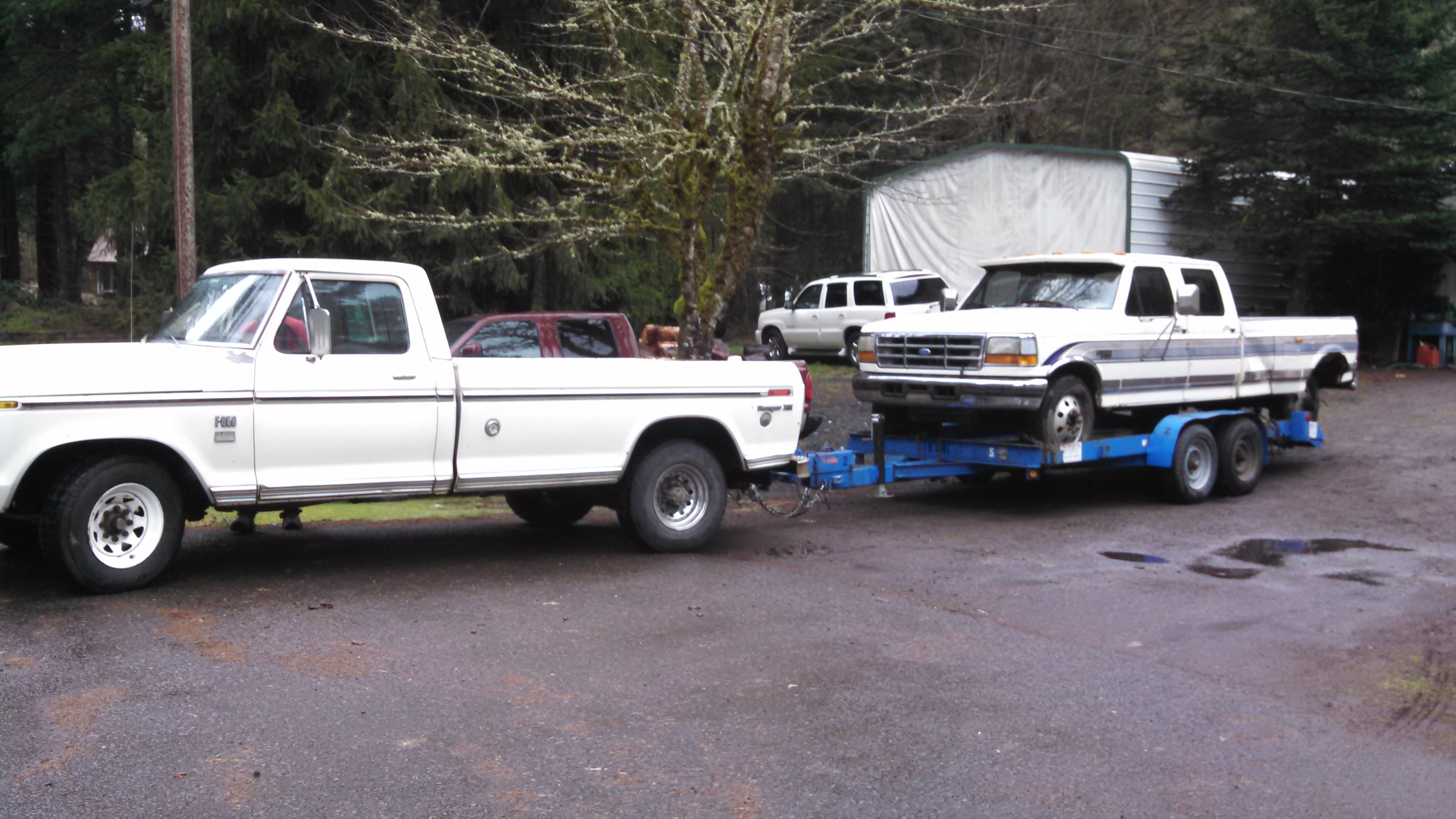 Found a standard truck with ac that i m going to put on it here it is towing home the 96 f350 psd we bought as a non runner