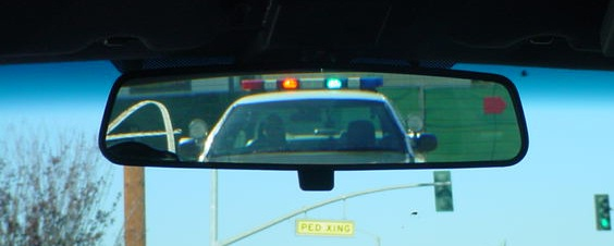 with his lights flashing  Police Lights In Rear View Mirror