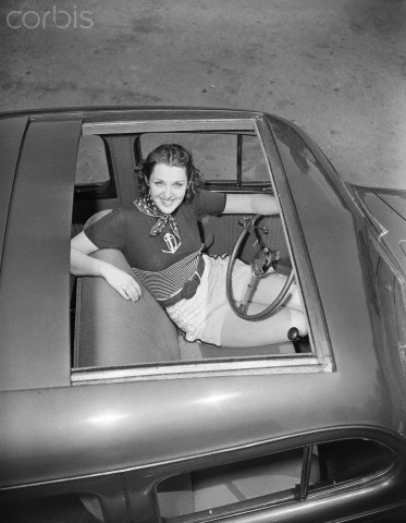Overhead Woman Sitting In Nash with Sunroof