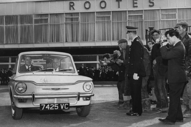Duke of Edinburgh drives a Hillman imp with Lord Rootes as passenger after opening the ill-fated Linwood factory. 1963 pic:SMG Newspapers Ltd